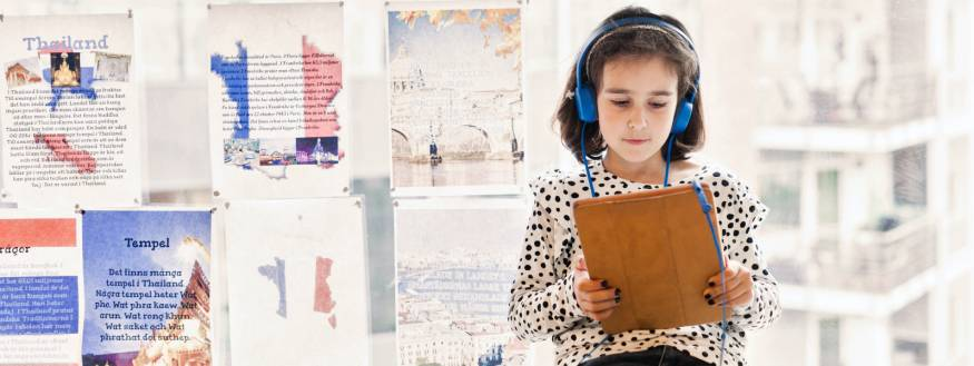 pretty pic of young girl studying with headphones