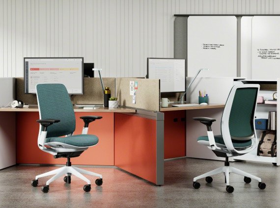 photo of two Steelcase Series1 chairs in blue at a desk